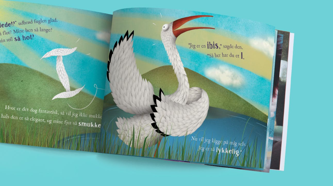 A picture of one of the book spreads with an ibis (bird) showing the letter I