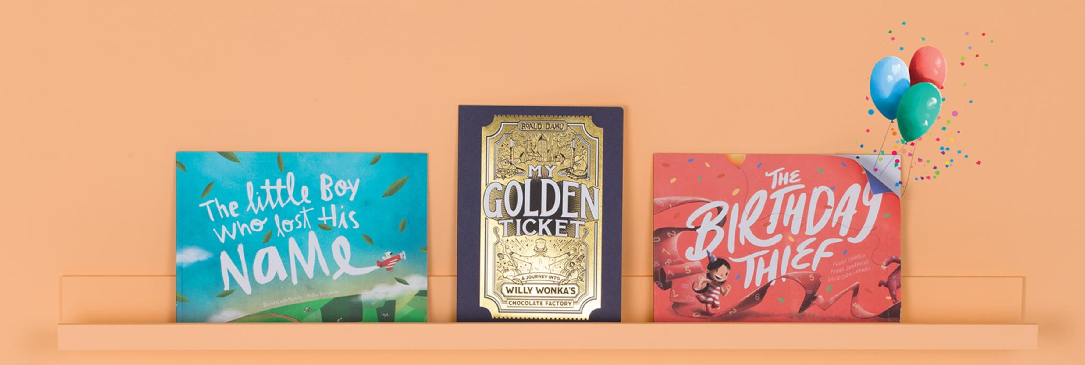 A bookshelf full of our Wonderbly books: Lost My Name, My Golden Ticket, The Birthday Thief