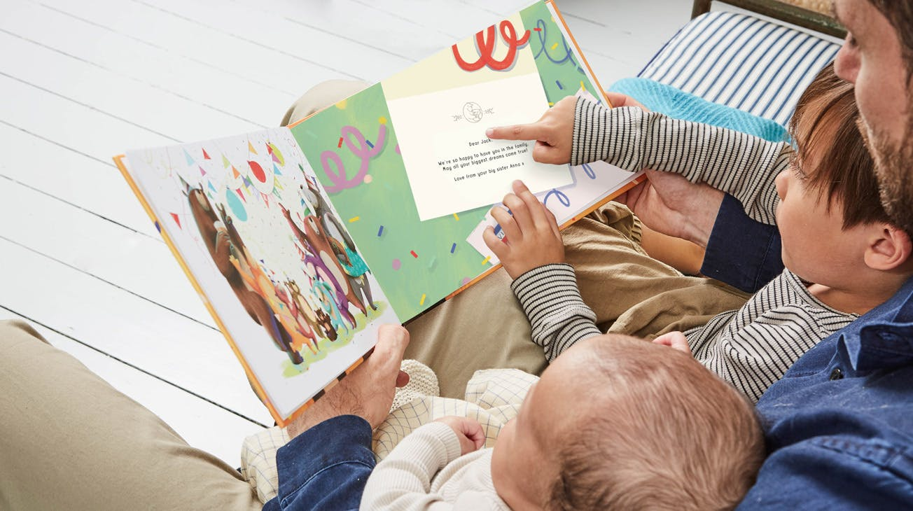 Image of family enjoying the littlest bear book.