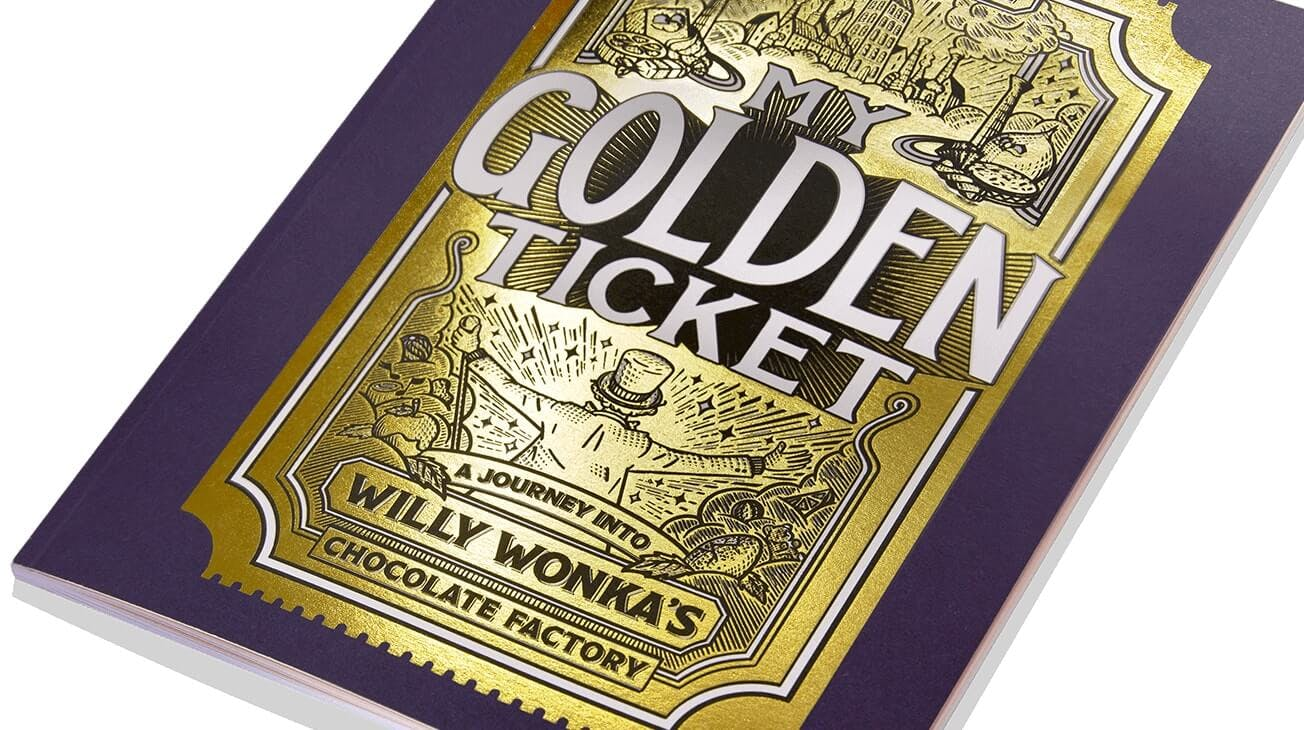 A close up shot of My Golden Ticket book with the golden ticket on the cover