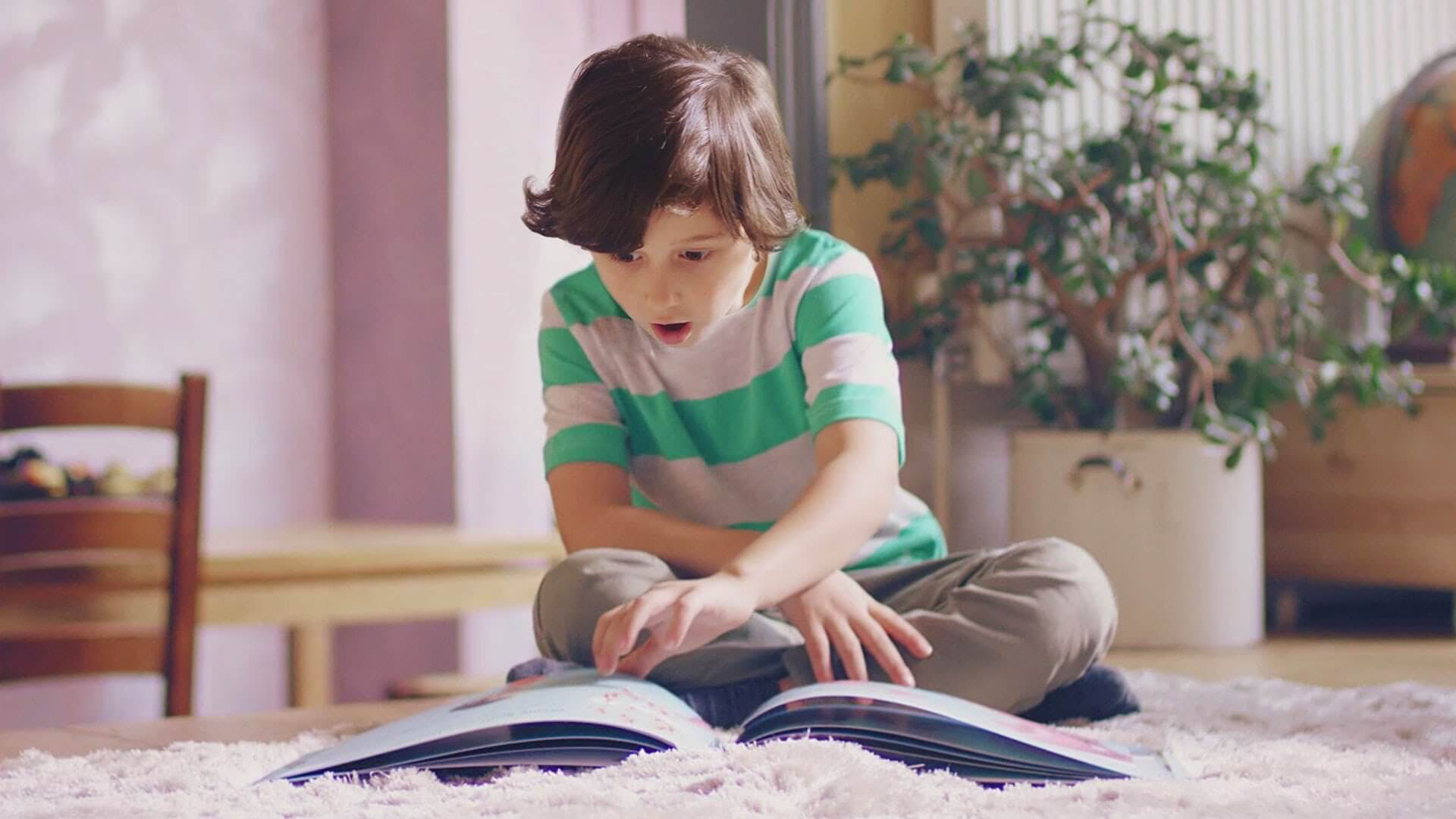Boy reading a Lost My Name book
