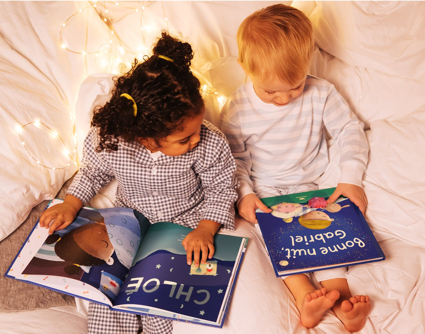 Two children on a bed reading Bedtime For You