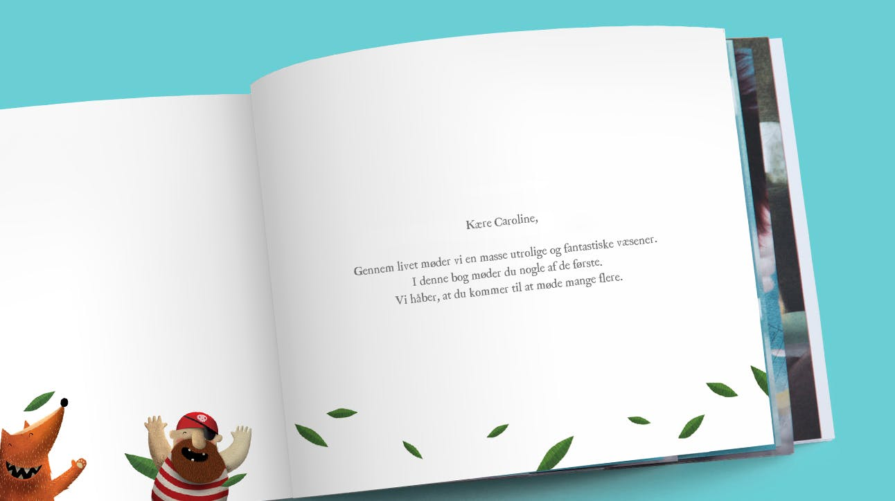 A picture of a custom dedication printed on the first page of the book in Danish